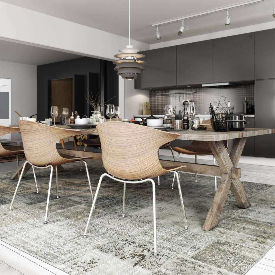 Svart / grått avlangt patchwork - turkiet - teppe i en kjøkken.